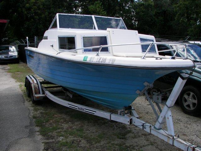 1977 OTHER CRUISE BOAT w/dual wheel trailer White and Blue